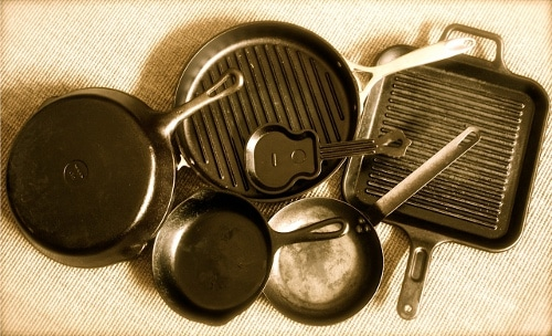 assortment of cast iron skillets round square