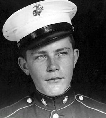Vintage military sailor portrait serious looking face.