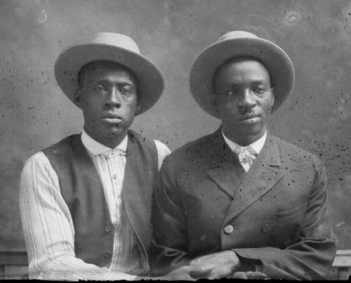 Vintage two men wearing hats black and white photo illustration.
