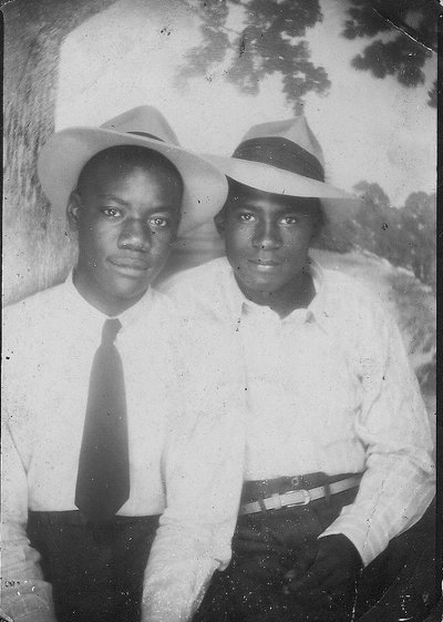 Vintage two young boys wearing hats close up black and white photo illustration.