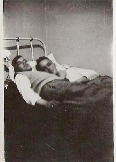 Vintage two young men sleeping on the bed black and white illustration.