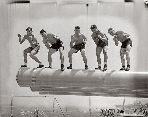 vintage sailors boxers standing on ship guns