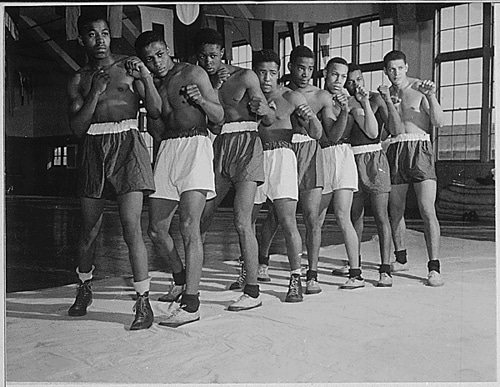 Vintage group of amateur boxers posing in shorts.