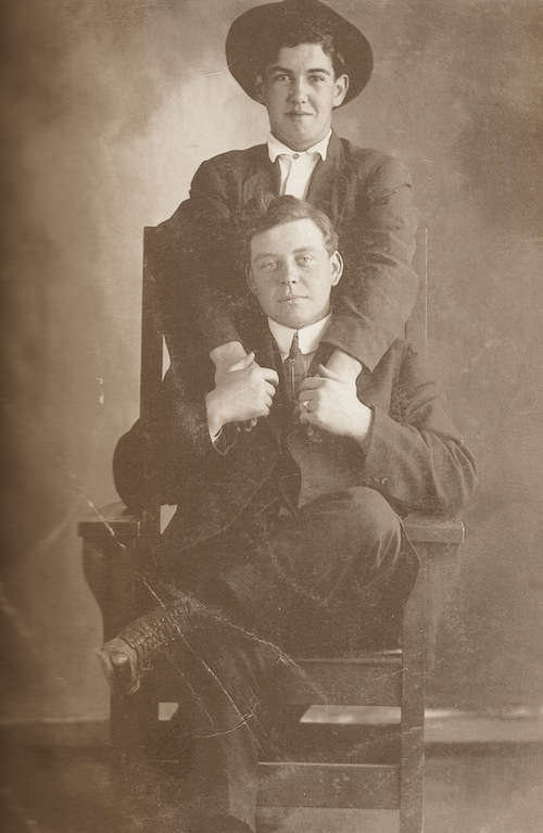 Vintage two men sitting and holding hands each other black and white photo illustration.