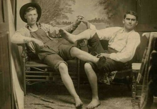 Vintage two men are siting on chair black and white photo illustration.