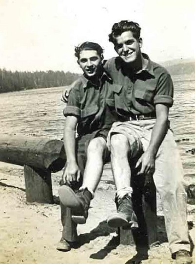 Vintage two young men are sitting and smiling black and white illustration.