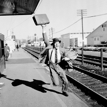 vintage man businessman suit running after train