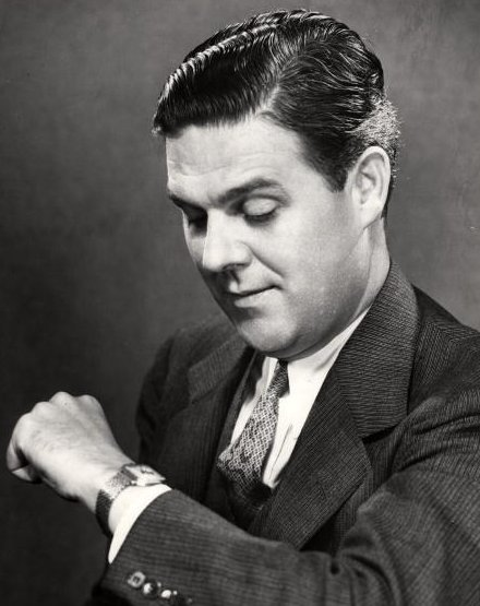 Vintage man businessman looking down at watch.