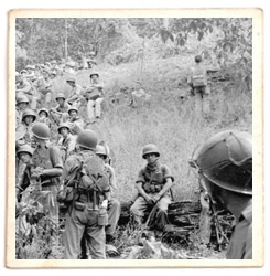Sid Phillips WWII soldier looking at troops.