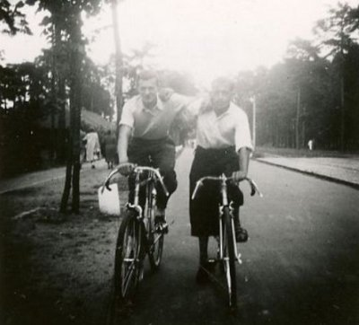 Vintage two young men cycling on the road black and white illustration.