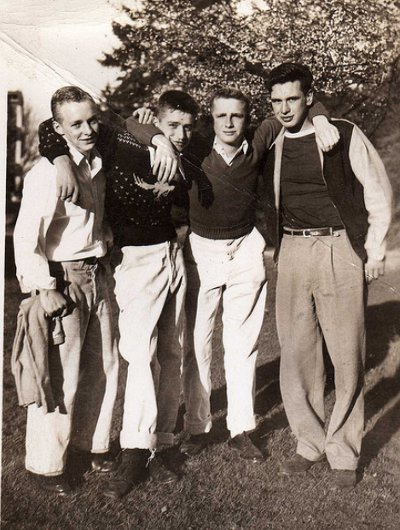 Vintage four young men standing black and white photo illustration.