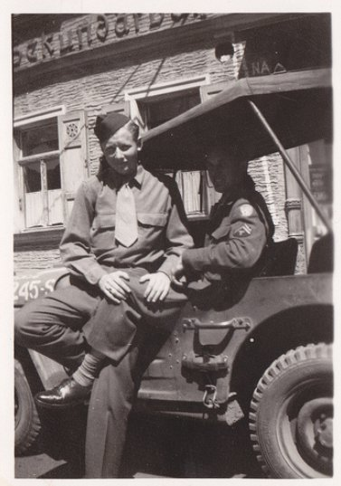 Vintage two army soldiers sitting on vehicle black and white illustration.