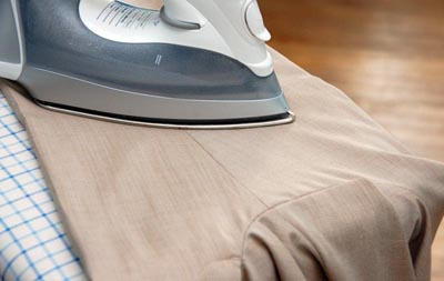 Iron pant trousers ironing crease in legs.