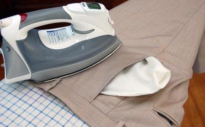 Ironing pants trousers iron top waistband.
