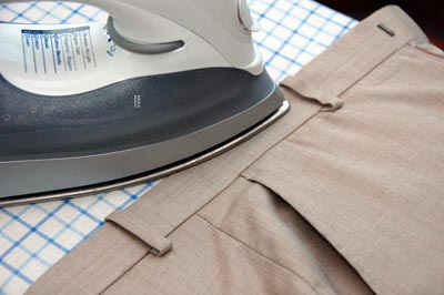 Ironing pants trousers iron top waistband.