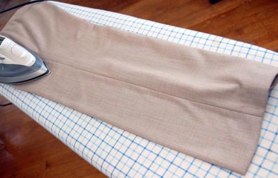 Iron pant trousers ironing leg next to seam.
