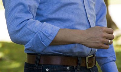 forearm rolled shirt sleeves close up photo