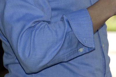 roll shirt sleeves close up photo arms