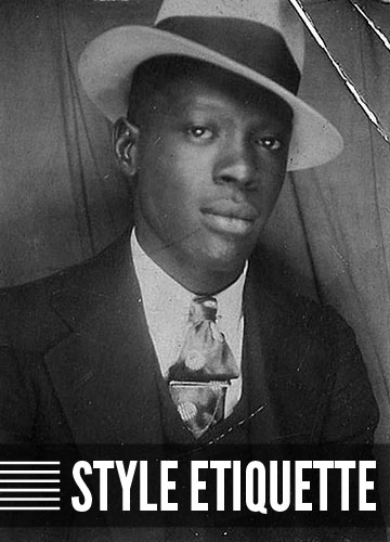 Vintage african american man in suit hat style etiquette.