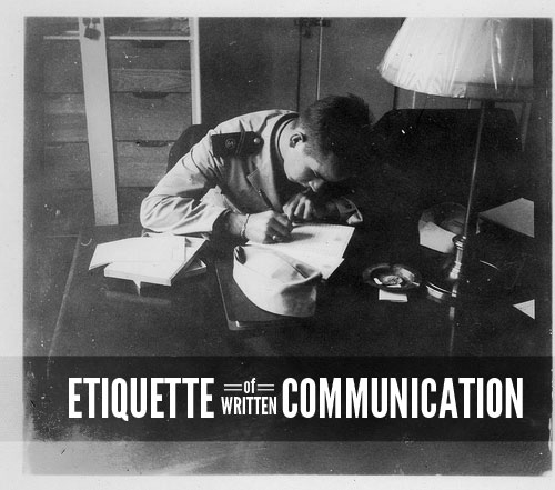 young sailor at desk writing letter etiquette communication