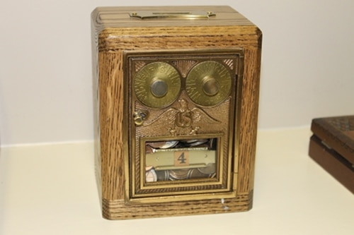 vintage coin bank made with door of old post office box