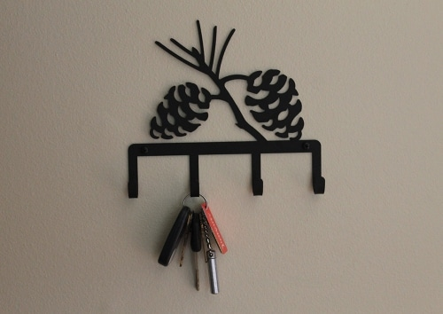 key hook in hallway pine cones