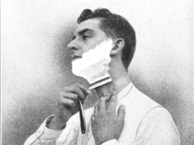 vintage man shaving neck with straight razor grainy