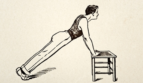 young man doing push up on short table illustration
