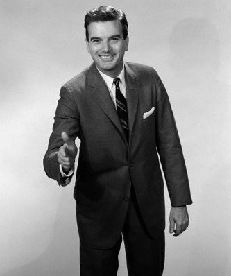 vintage businessman extending hand for handshake smiling
