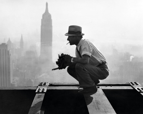 Vintage photographer on skyscraper empire state building.