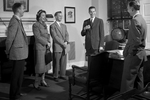 vintage men woman in business meeting laughing smiling