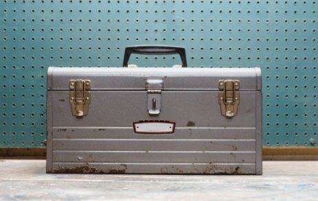 gray worn toolbox teal checkerboard behind