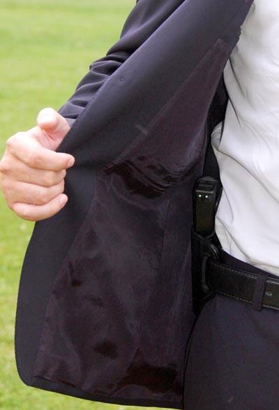 Concealed carry style blazer handgun showing jacket open.