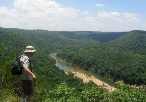 man hiking above buffalo national river vista