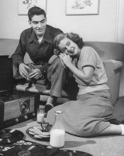 vintage couple on date listening to records turntable