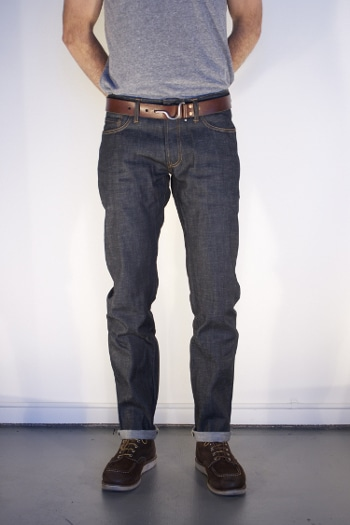 fitted raw denim jeans rolled cuffs with boots leather belt