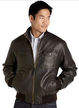 young asian man wearing leather jacket