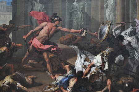 perseus painting in battle with other men pink skirt