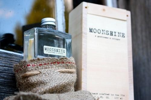 moonshine cologne bottle in bag wooden box