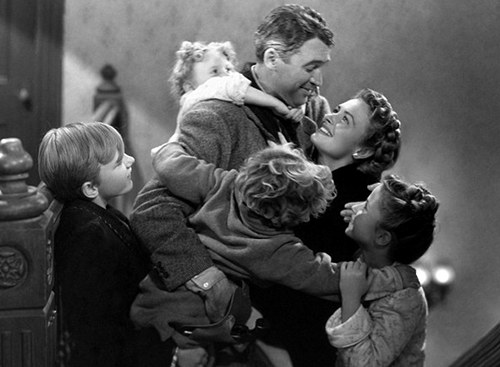 "George Bailey in ""It's a wonderful life"" movie while hugging his family."