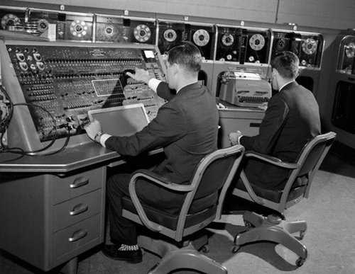 vintage men working at computer programming work stations