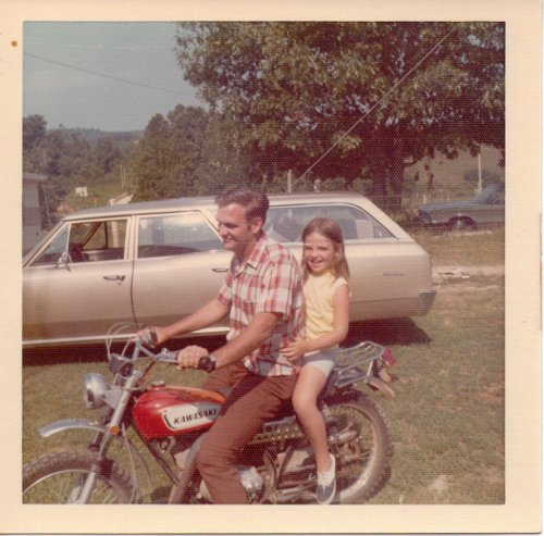 Vintage uncle with niece riding motorcycle 1970s.