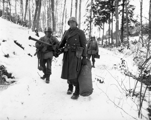 wwii soldiers christmas 1944 walking snowy ground forest