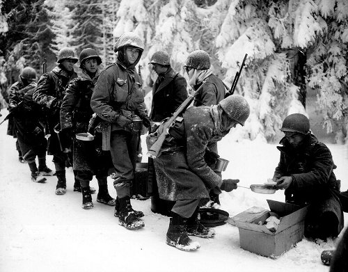 vintage wwii soldiers being served rations snowy forest