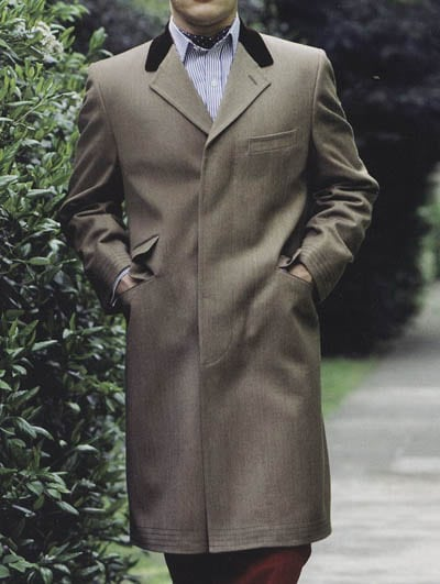 Light colored covert coat overcoat.
