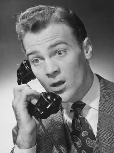 vintage man on telephone surprised look on face