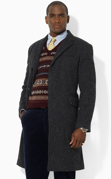 African American black man wearing gray overcoat over sweater.