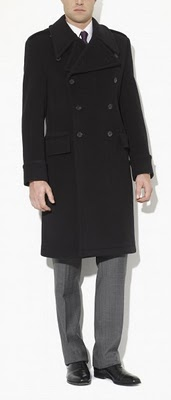 Dark colored paletot overcoat with gray trousers.