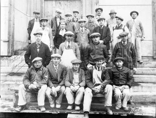 vintage group of men wearing flat caps