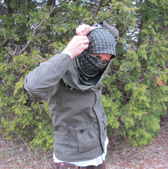 Man tie a military-style scarf Shemagh Keffiyeh.
